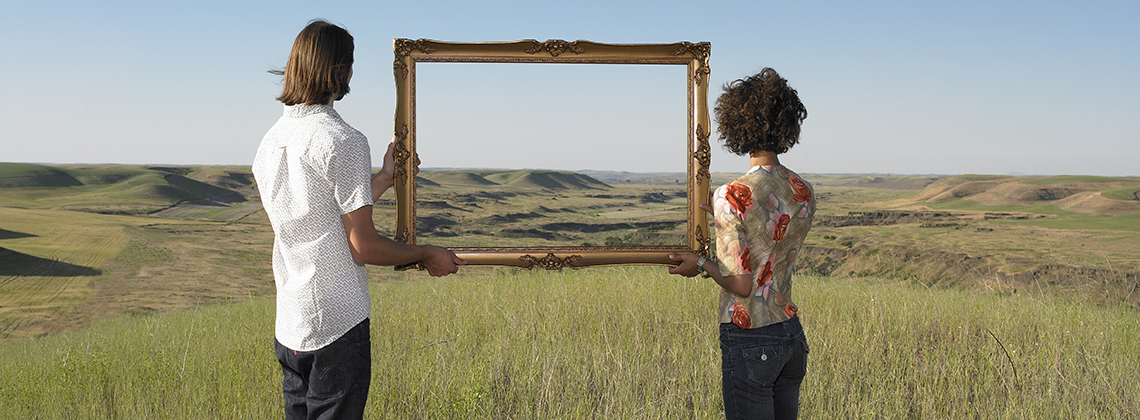 man and woman holding frame